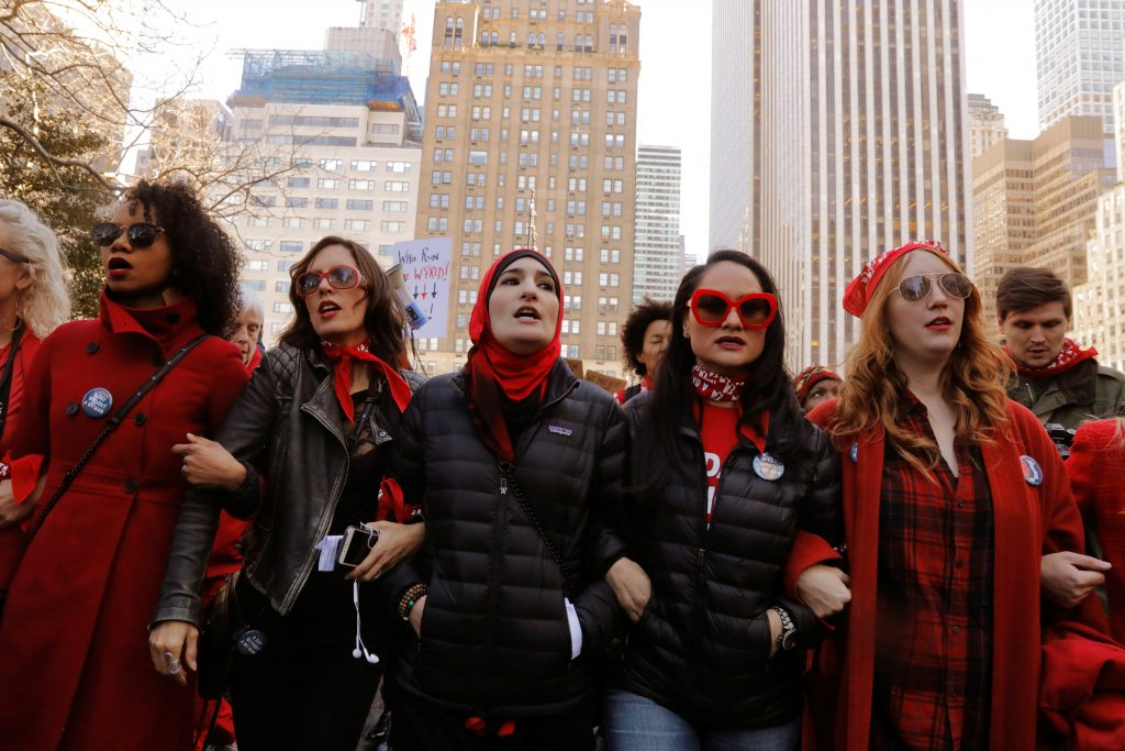 Organizers Linda Sarsour (C), Carmen Perez (2nd R) and Bob Bland (R) lead during a 'Day Without a Woman' march on International Women's Day, March 8, in New York City. Photo by REUTERS/Lucas Jackson.