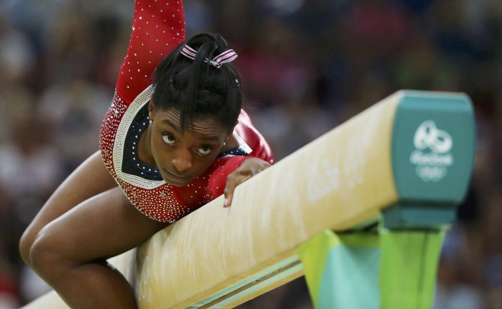 Simone Biles (USA) competes in the 2016 Rio Olympics. Photo by REUTERS/Mike Blake.