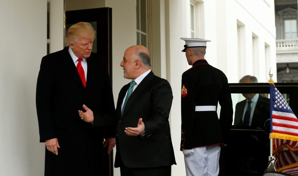 President Donald Trump greets Iraqi Prime Minister Haider al-Abadi at the White House in Washington, D.C. al-Abadi is meeting with an anti-ISIS coalition this week in Washington. Photo by REUTERS/Kevin Lamarque.