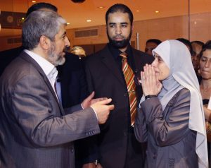 Former Jordanian prisoner Ahlam Tamimi (R) talks to Hamas leader Khaled Meshaal after arriving in Cairo October 18, 2011, following her release and deportation from an Israeli jail. Tamimi had been sentenced to 16 life terms for her involvement in a suicide bombing attack on the Sbarro Pizzeria in Jerusalem in August 2001. On March 14, the FBI added Al-Tamimi, who served eight years in prison after pleading guilty in an Israeli court, to its list of Most Wanted Terrorists. Photo by REUTERS/Jamal Saidi.