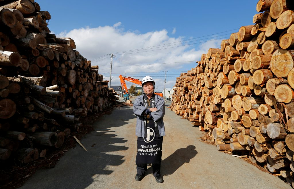 Owner of Asada timber factory, Munehiro Asada, poses for a photo at his factory's timber-yard in Namie town, near Tokyo Electric Power Co's (TEPCO) tsunami-crippled Fukushima Daiichi nuclear power plant. Residents will return to the town after six years starting April 1. Photo by REUTERS/Toru Hanai