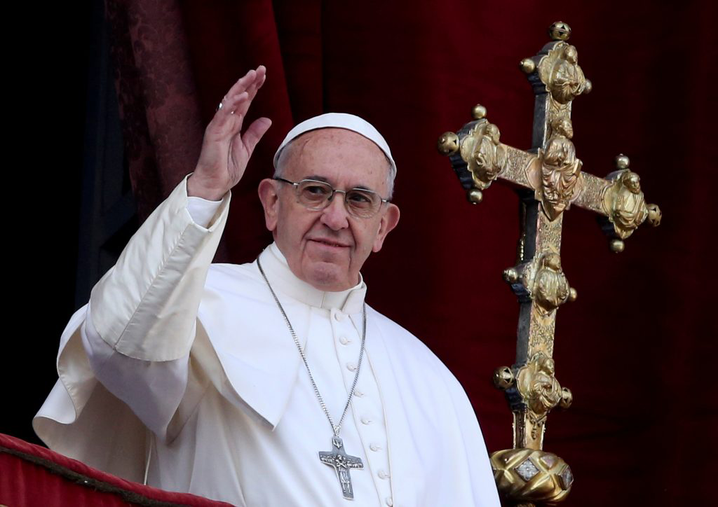 Pope Francis waves after delivering his