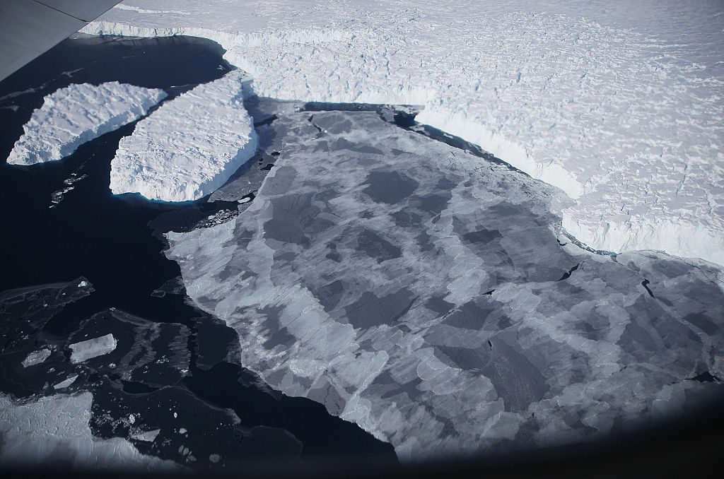 Ice floats near the coast of West Antarctica as viewed from a window of a NASA Operation IceBridge airplane on October 28, 2016 in-flight over Antarctica. Photo by Mario Tama/Getty Images.
