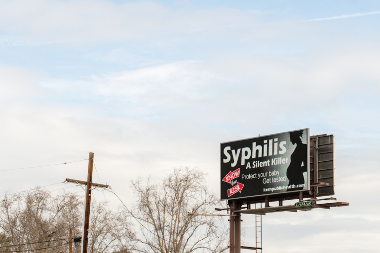 "An electronic billboard near downtown Bakersfield, Calif., displays a public service announcement about sexually transmitted diseases on February 2, 2017. The Kern County public health department has embarked on a massive information campaign with the slogan, ""Know Your Risk.""   (Heidi de Marco/KHN)"