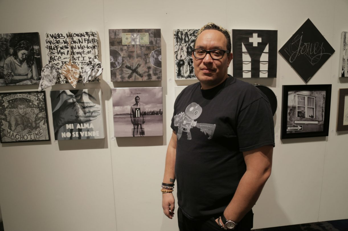 Artist Vagabond Beaumont stands next to his contribution to 'CitiCien,' center bottom. Photo by Zachary Green