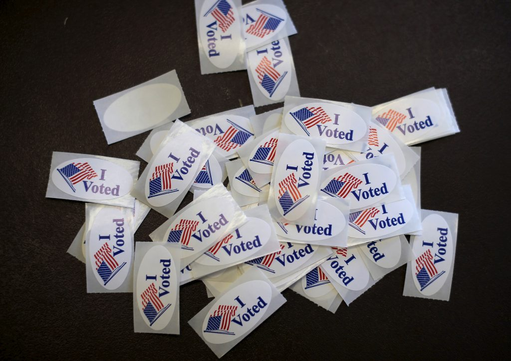 Stickers are seen on a table at a polling stations for the Wisconsin presidential primary election in Milwaukee, Wisconsin. Photo by Jim Young/Reuters