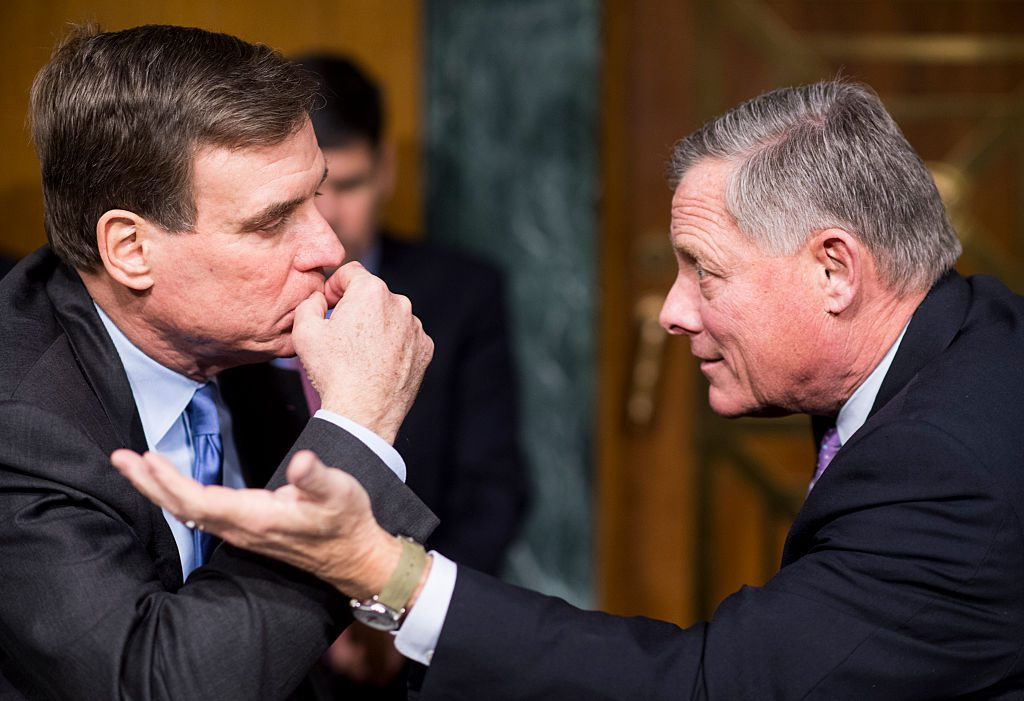 """Vice chair Sen. Mark Warner, D-Va., left, and chairman Sen. Richard Burr, R-N.C., confer Jan. 10 before the start of the Senate (Select) Intelligence Committee hearing on """"Russian Intelligence Activities."""" Photo by Bill Clark/CQ Roll Call."""