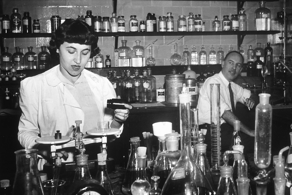 The beginning of the chemotherapy testing program. J. Hartwell (right) and assistant at NCI about 1950. Photo by National Cancer Institute, National Institutes of Health