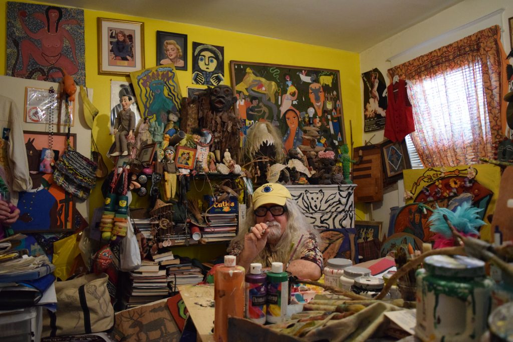 Brian Dowdall in his studio in his Baltimore home, surrounded by outsider art he's collected over the years. Photo: Elizabeth Flock