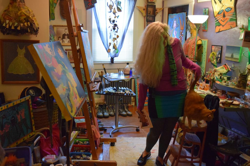 "Alison Spiesman in her studio, where she has begun painting more visionary art after 10 years of being ""mute,"" and unable to paint. Photo: Elizabeth Flock"