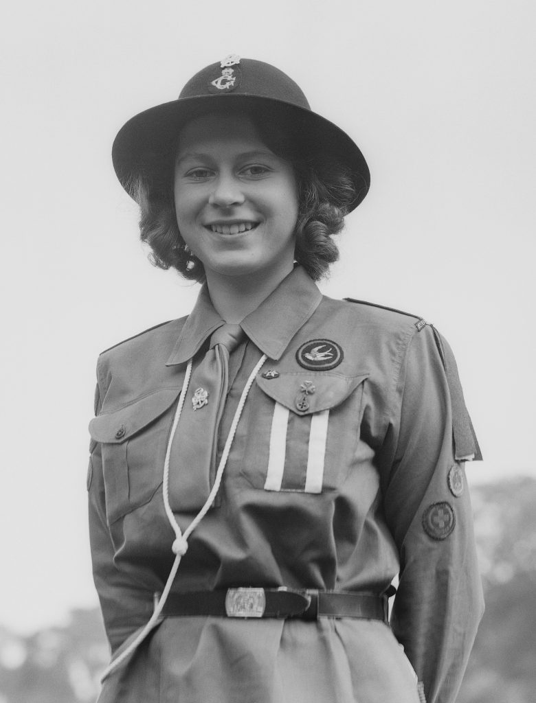 Princess Elizabeth poses in her girl guide (scouts) uniform in Frogmore, Windsor, England on April 11, 1942. Photo by Studio Lisa/Getty Images