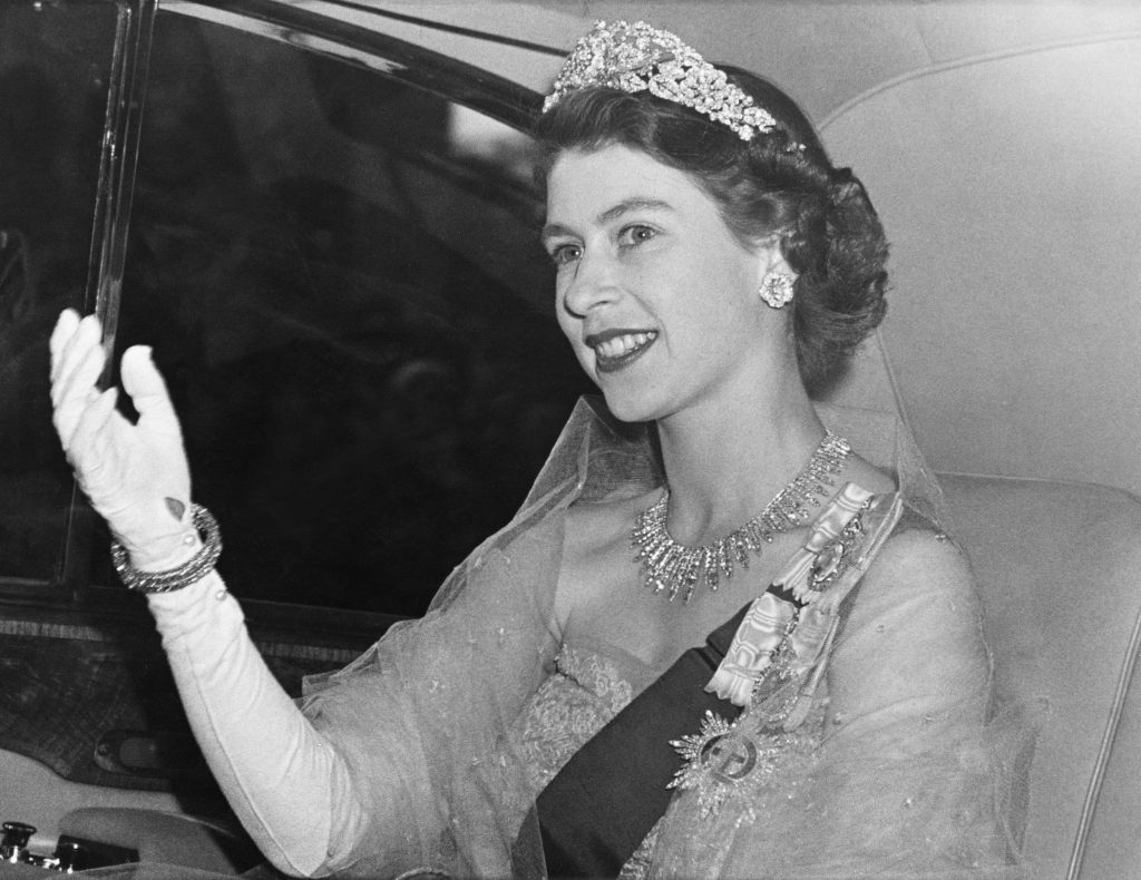 Princess Elizabeth arrives at the Norwegian Embassy in London for a dinner party hosted by King Haakon VII of Norway on June 6, 1951, giving the famous royal wave. Photo by Paul Popper/Popperfoto/Getty Images