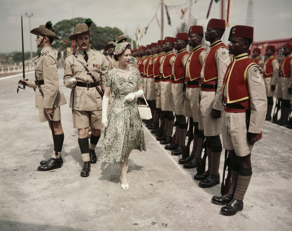 Queen Elizabeth II inspects men of the newly renamed Queen's Own Nigeria Regiment, Royal West African Frontier Force, at Kaduna Airport, Nigeria, during her Commonwealth Tour on Feb. 2, 1956. Photo by Fox Photos/Hulton Archive/Getty Images