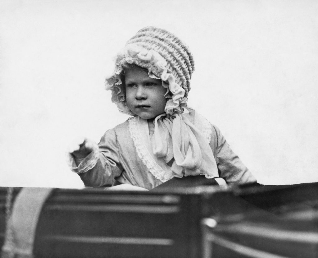 The young Princess Elizabeth, seen here in 1928, already demonstrates a fancy for elaborate hats. Photo by Central Press/Hulton Archive/Getty Images