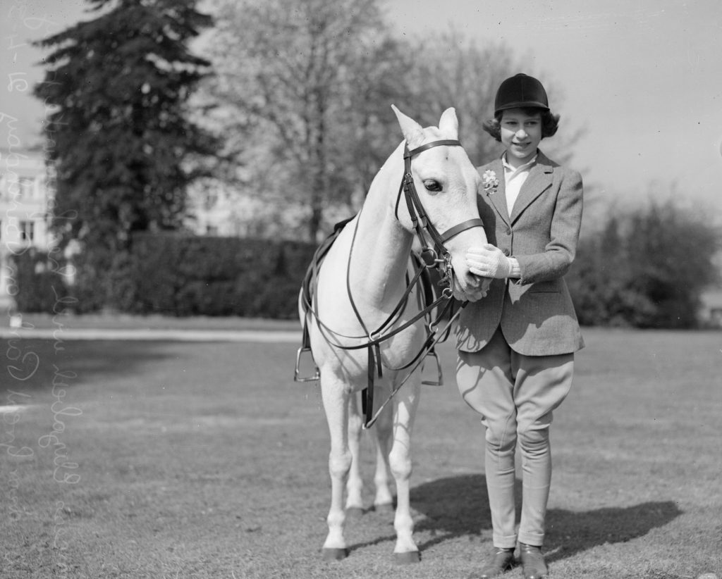 Then-Princess Elizabeth pats her pony in Windsor Great Park, Berkshire, on her 13th birthday on April 21, 1939. Photo by Central Press/Getty Images