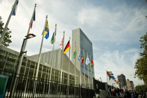 Flags of member nations in front of the United Nations headquarters in New York. Photo by Michael Gottschalk/Photothek via Getty Images