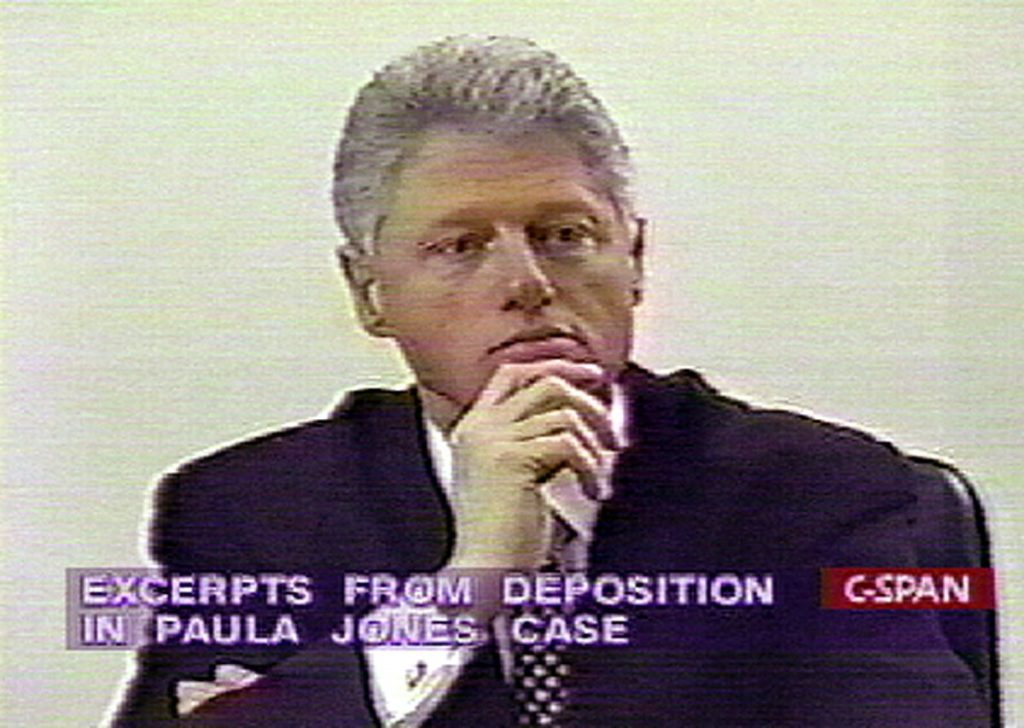 WASHINGTON, : This 10 December image taken from C-Span television shows US President Bill Clinton giving videotaped sworn deposition in tha Paula Jones sexual discrimination suit. The tape was played during impeachment hearings conducted by the US House Judiciary Committee on Capitol Hill 10 December in Washington, DC. AFP PHOTO/C-SPAN (Photo credit should read AFP/AFP/Getty Images)