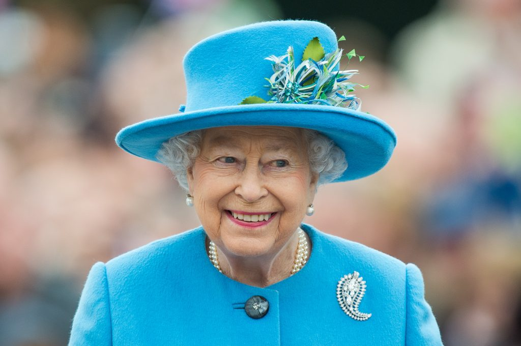 Queen Elizabeth II celebrated her 91st birthday on Friday. Here, in a 2016 photo in Poundbury, Dorset, she matches perfectly in a turquoise ensemble. Photo by Samir Hussein/WireImage via Getty Images