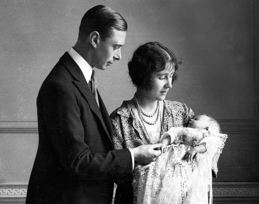The Duke and Duchess of York (later King George VI and Queen Elizabeth, the Queen Mother) pictured in 1926 with their daughter (later, Queen Elizabeth II) in a christening robe, which has been used in the Royal Family for generations. Photo by Popperfoto/Getty Images