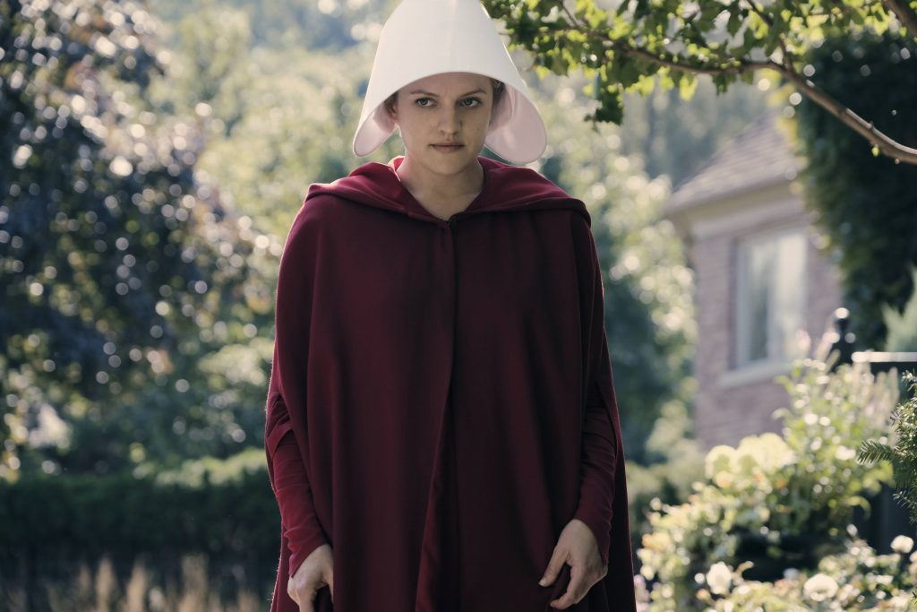 "The Handmaid's Tale -- ""Offred"" Episode 101 -- Offred, one the few fertile women known as Handmaids in the oppressive Republic of Gilead, struggles to survive as a reproductive surrogate for a powerful Commander and his resentful wife. Offred (Elisabeth Moss), shown. (Photo by: George Kraychyk/Hulu)"