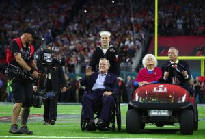 President George H.W. Bush and Barbara Bush arrives for the coin toss prior to February's Super Bowl 51 between the Atlanta Falcons and the New England Patriots at NRG Stadium  in Houston, Texas.  Photo by Al Bello/Getty Images.