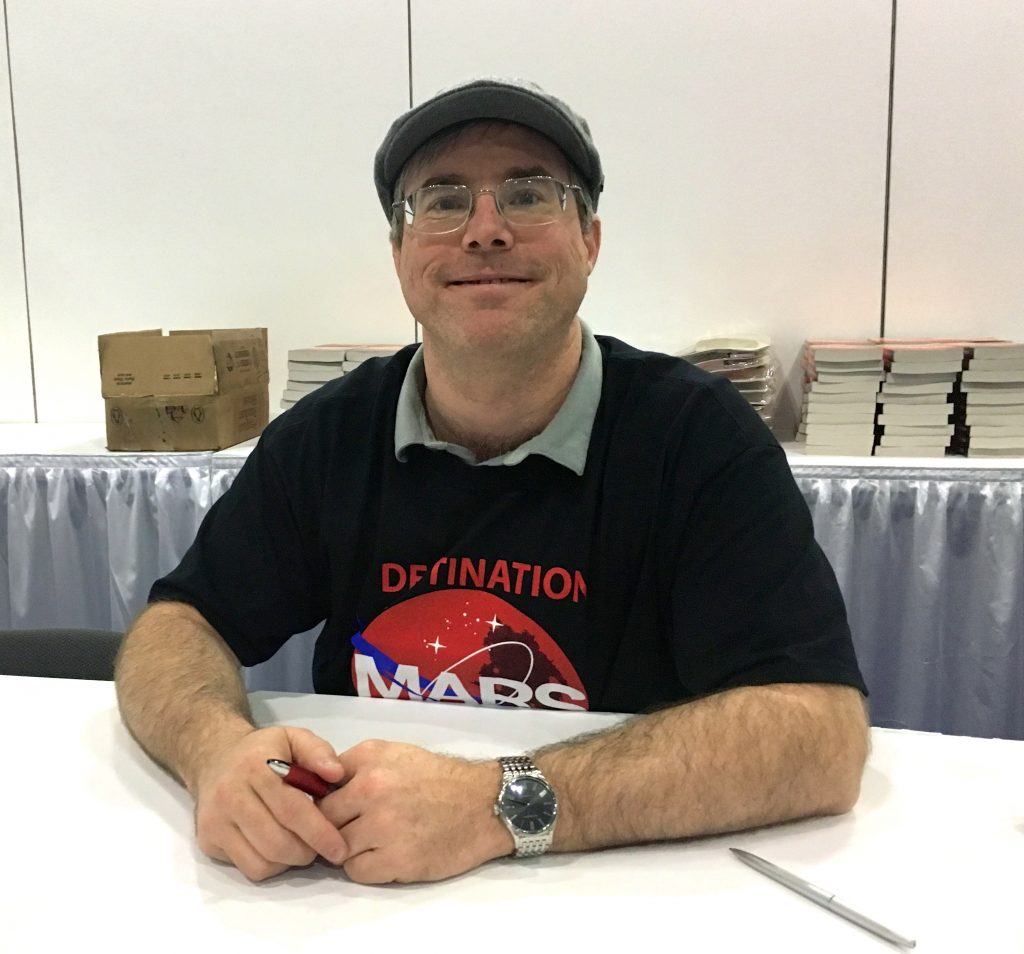 Andy Weir waits to sign copies of his book The Martian at the National Science Teachers Association conference in Los Angeles. Weir gave the keynote address to many of the 10,000 teachers who attended the conference, some of whom have used his book as a teaching tool in their classroom. Photo by Victoria Pasquantonio