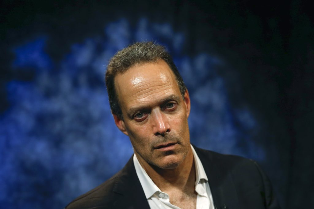Sebastian Junger, director of the Oscar-nominated war documentary Restrepo and its upcoming sequel Korengal, sits for a portrait in New York May 28, 2014. REUTERS/Shannon Stapleton (UNITED STATES - Tags: ENTERTAINMENT HEADSHOT) - RTR3R9ZZ