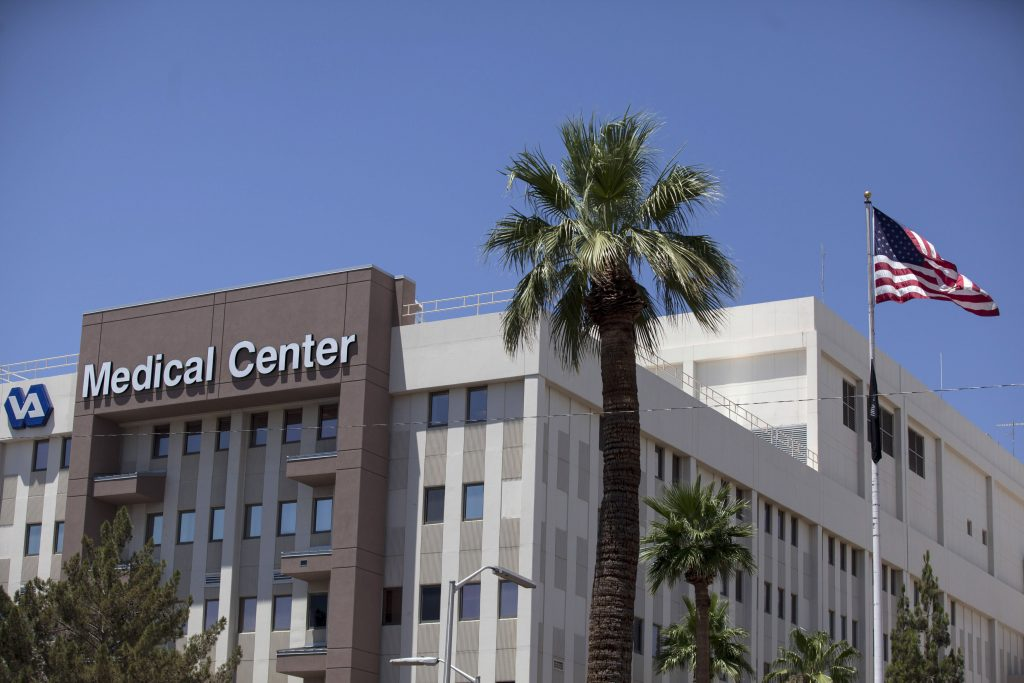 The Carl T. Hayden VA Medical Center is pictured in Phoenix, Arizona June 11, 2014. Federal Bureau of Investigation agents will investigate allegations of wrongdoing at an Arizona office of the Veterans Affairs department that became a political problem for President Barack Obama and forced the VA chief to resign. On Monday, the VA released an internal audit that found more than 100,000 veterans were subjected to a wait of 90 days or more for healthcare appointments, and widespread instances of schemes to mask the delays to meet targets for bonuses. REUTERS/Samantha Sais (UNITED STATES - Tags: POLITICS MILITARY HEALTH CRIME LAW) - RTR3TAA8