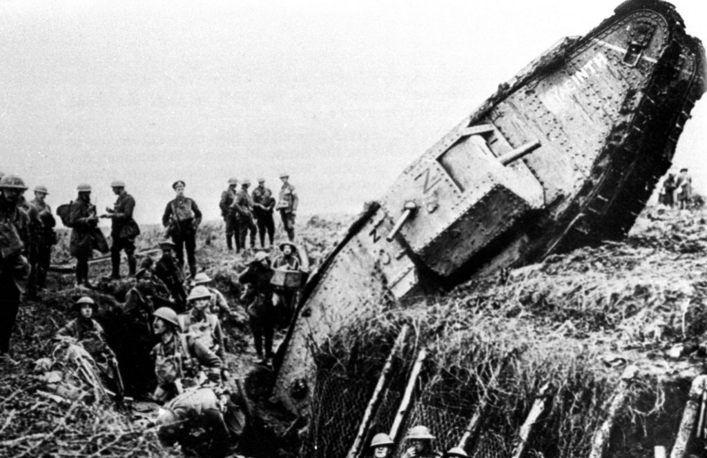 Tanks were developed to barrel over trenches filled with soldiers. Here, a British Mark IV tank didn't quite make it during the British-German Battle of Cambrai in France, Nov. 20, 1917. Handout/Files via Reuters