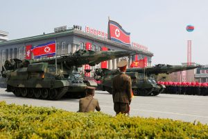 Missiles are driven past the stand with North Korean leader Kim Jong Un and other high ranking officials during a military parade marking the 105th birth anniversary of North Korea's founding father, Kim Il Sung, in Pyongyang, April 15, 2017. Photo By Sue-Lin Wong/Reuters