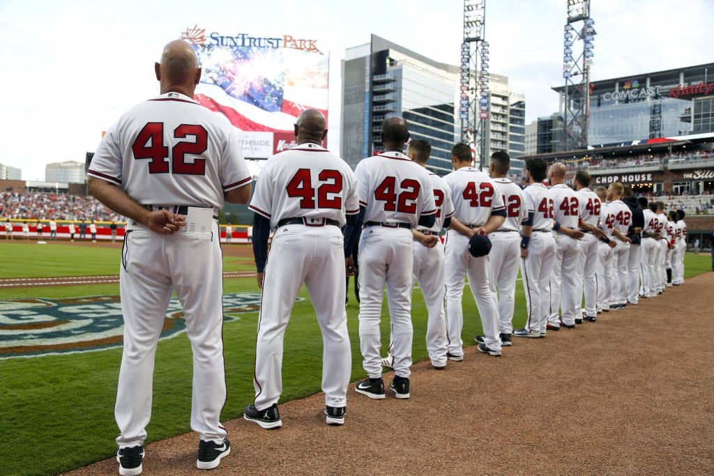 Atlanta Braves coaches and players wearing the No. 42 in honor of Jackie Robinson stand during the national anthem before a game against the San Diego Padres at SunTrust Park. Photo by Brett Davis/USA TODAY Sports