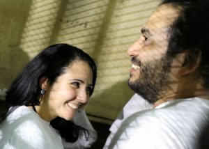 Aya Hijazi and her husband Mohamed Hassanein, founders of Belady, an NGO that promotes a better life for street children, talk inside a holding cell in Cairo, Egypt. Picture taken March 23, 2017. Photo by Mohamed Abd El Ghany/Reuters