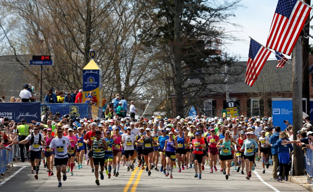 Runners from wave 4 cross the starting line for the 121st running of the Boston Marathon in Hopkinton, Massachusetts, on April 17, 2017. Photo by Lisa Hornak/Reuters
