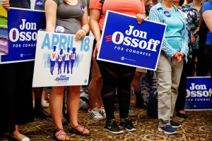 Supporters of Democratic candidate Jon Ossoff, running for Georgia's 6th Congressional District special election to to fill the seat of Republican Tom Price who was appointed as secretary of Health and Human Services, listen to him speak during an election eve rally at Andretti Indoor Karting and Games in Roswell, Georgia, U.S. April 17, 2017. Picture taken April 17, 2017. REUTERS/Kevin D. Liles - RTS12SL4