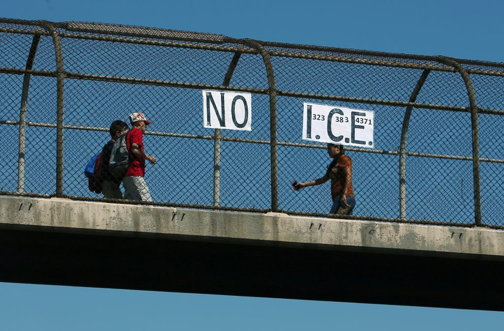"""A """"NO I.C.E."""" (U.S. Immigration and Customs Enforcement) sign seen on a pedestrian overpass crossing a freeway in Los Angeles, California. Photo by Mike Blake/Reuters"""