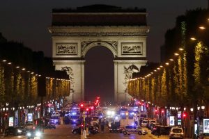 Police secure the Champs Elysees Avenue after one policeman was killed and another wounded in a shooting incident in Paris, France, today. Photo by Christian Hartmann/Reuters