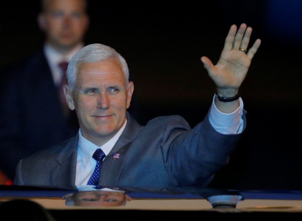 U.S. Vice President Mike Pence waves as he arrives at Sydney International Airport in Australia, April 21, 2017. REUTERS/Jason Reed - RTS13B52