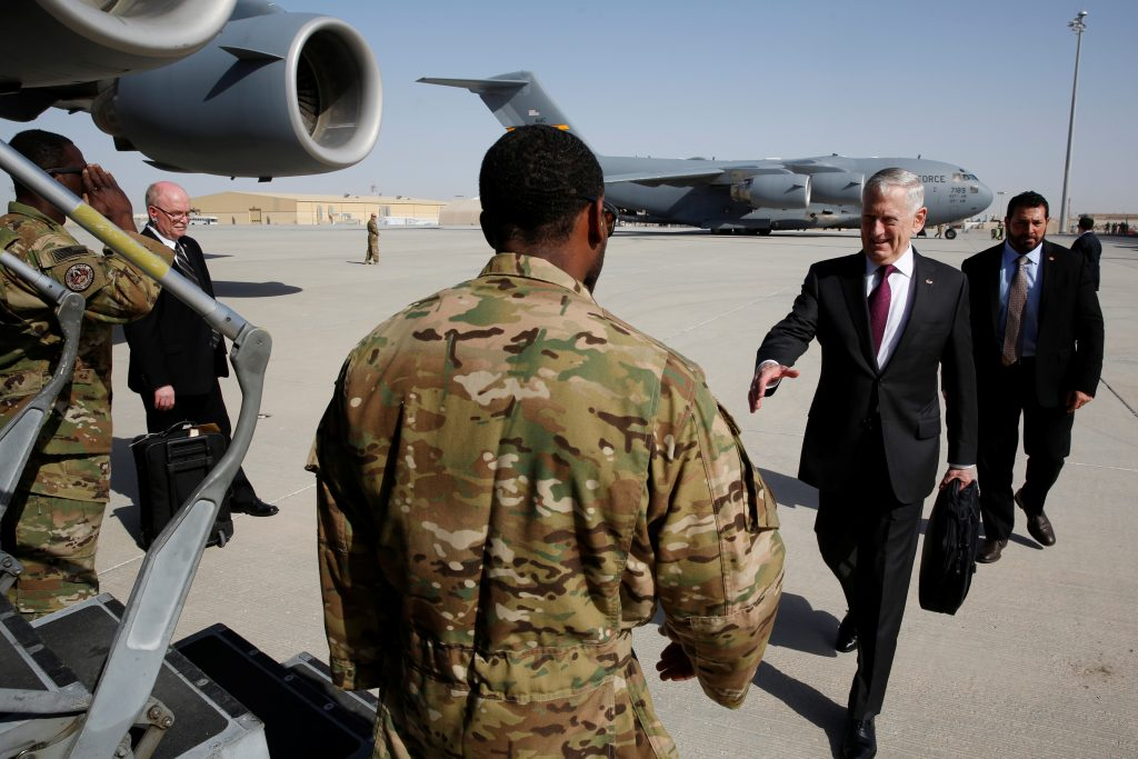 Mattis boards a U.S. Air Force C-17 for a day trip to a U.S. military base in Djibouti from Doha, Qatar