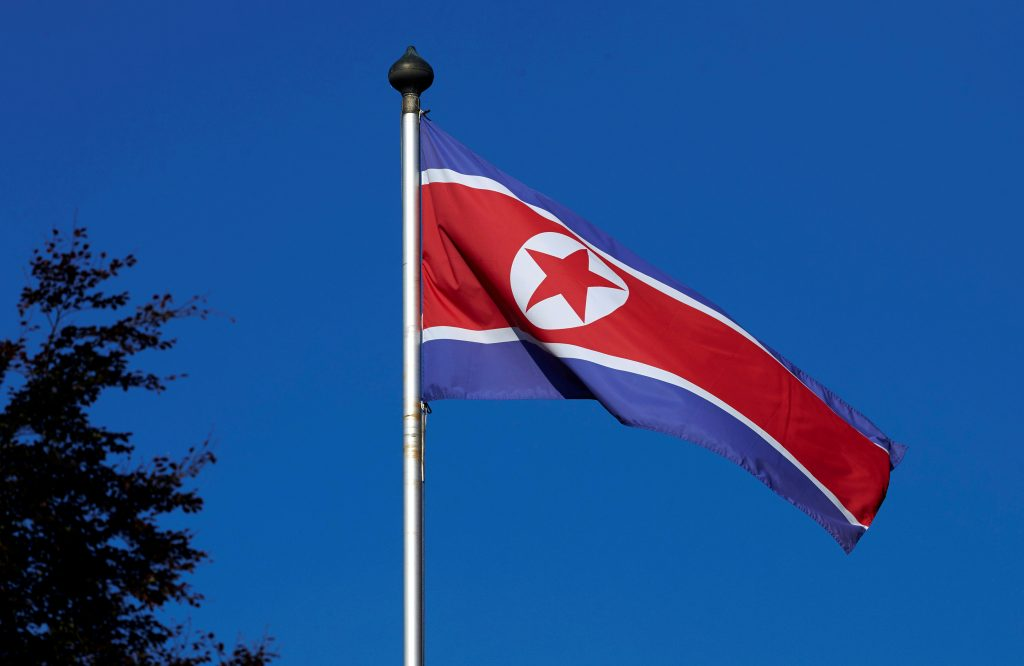 A North Korean flag flies on a mast at the Permanent Mission of North Korea in Geneva in 2014. Photo by Denis Balibouse/Reuters