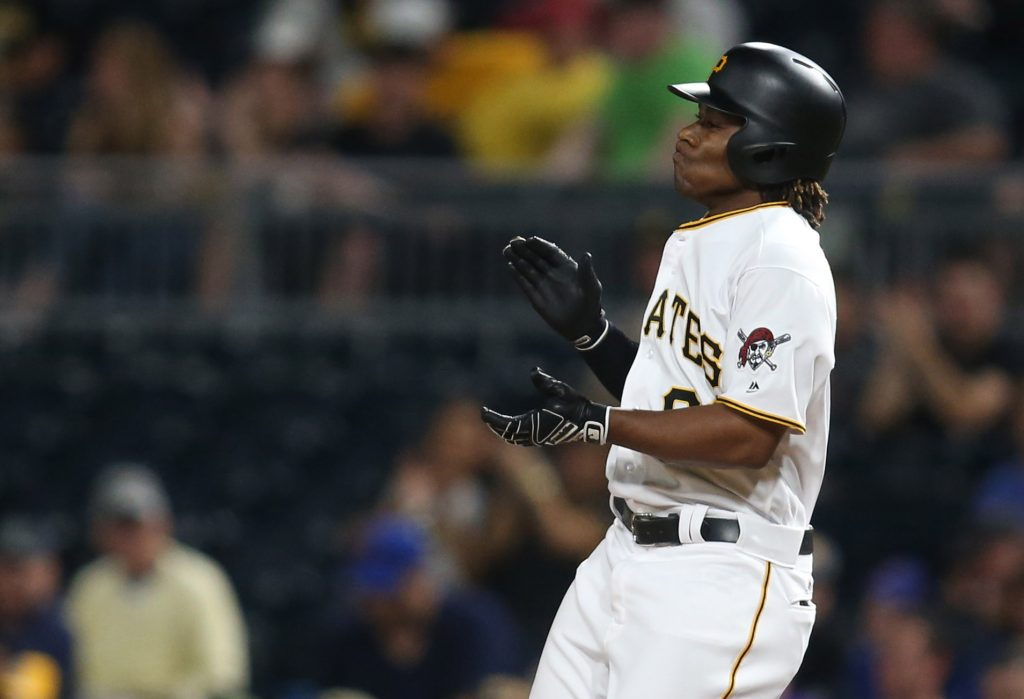 Pittsburgh Pirates second baseman Gift Ngoepe (No. 61) reacts after recording his first major league hit against the Chicago Cubs during the fourth inning at PNC Park. Photo by Charles LeClaire/USA TODAY Sports