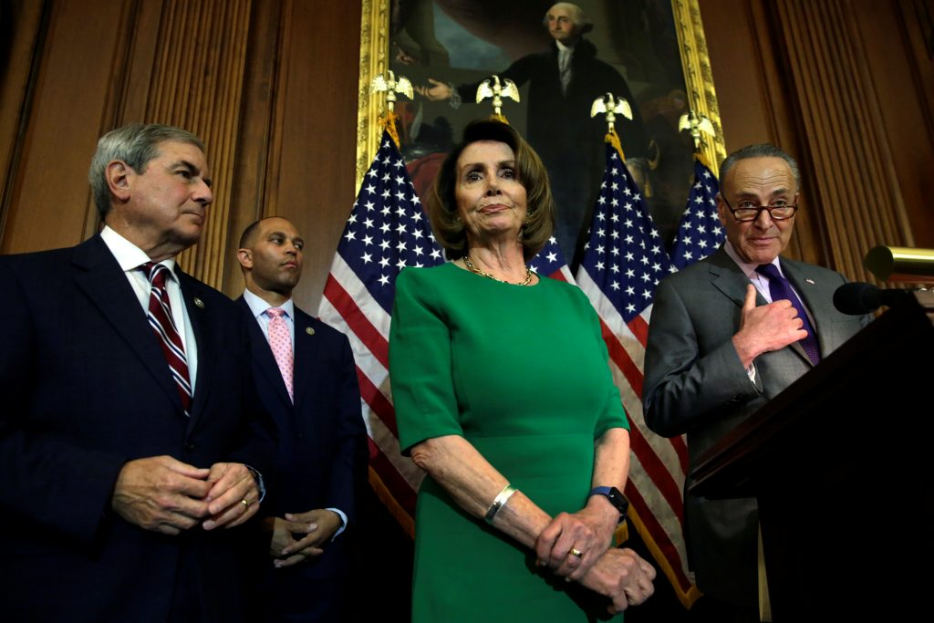 U.S. Senate Minority Leader Chuck Schumer (D-NY) (R) speaks next to House Minority Leader Nancy Pelosi (D-CA) during a news conference on President Trump's first 100 days on Capitol Hill in Washington, U.S April 28, 2017. REUTERS/Yuri Gripas - RTS14CNR
