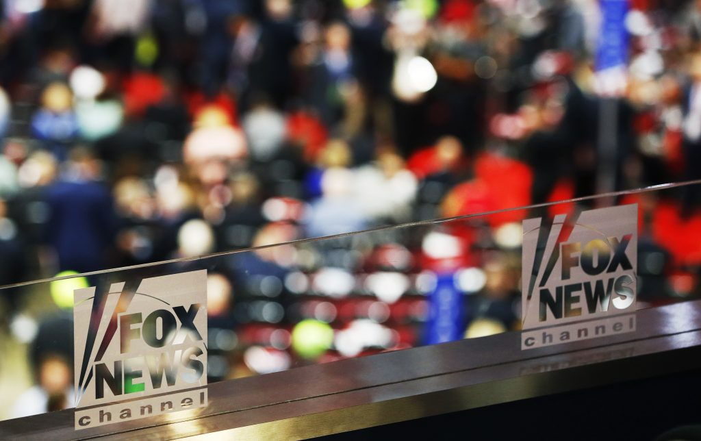 The logos of Fox News Channel are seen engraved on the glass of one of their booths at the 2016 Republican National Conven...