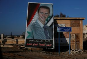 A poster of Syria's President Bashar Assad is seen in Ramouseh, a government controlled area of Aleppo, Syria. Photo by Omar Sanadiki/Reuters
