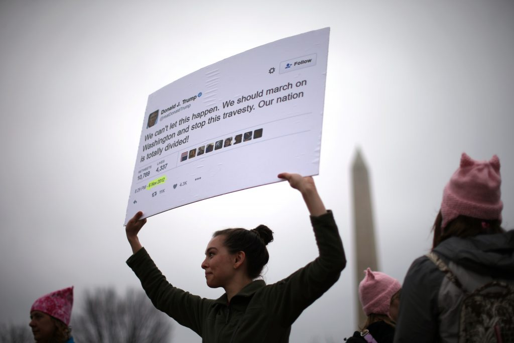 Marianne Nepsund, 29, from New York, holds a sign displaying one of U.S. President Donald Trump's tweets as she participates in the Women's March on Washington, following Trump's inauguration in January. Photo by Lucy Nicholson/Reuters