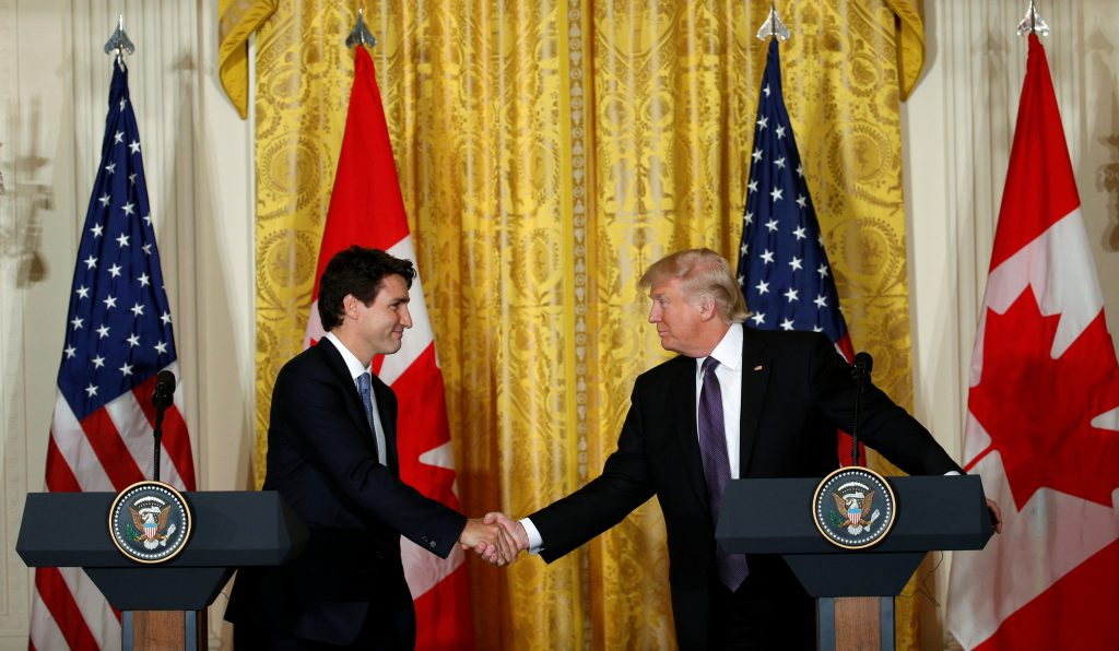 Canadian Prime Minister Justin Trudeau (L) and U.S. President Donald Trump shake hands during a joint news conference at the White House in Washington, U.S., February 13, 2017. Photo by Kevin Lamarque/Reuters