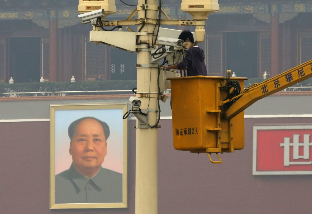 A man works on a security camera that was installed at Tiananmen Square in Beijing in 2013. China's domestic security chief believed a fatal vehicle crash in Beijing's Tiananmen Square in which five died was planned by a Uighur separatist group, designated as a terrorist organization by the U.S. and UN. Beijing, then, said the East Turkestan Islamic Movement was behind the attack. Photo by Kim Kyung-Hoon/Reuters