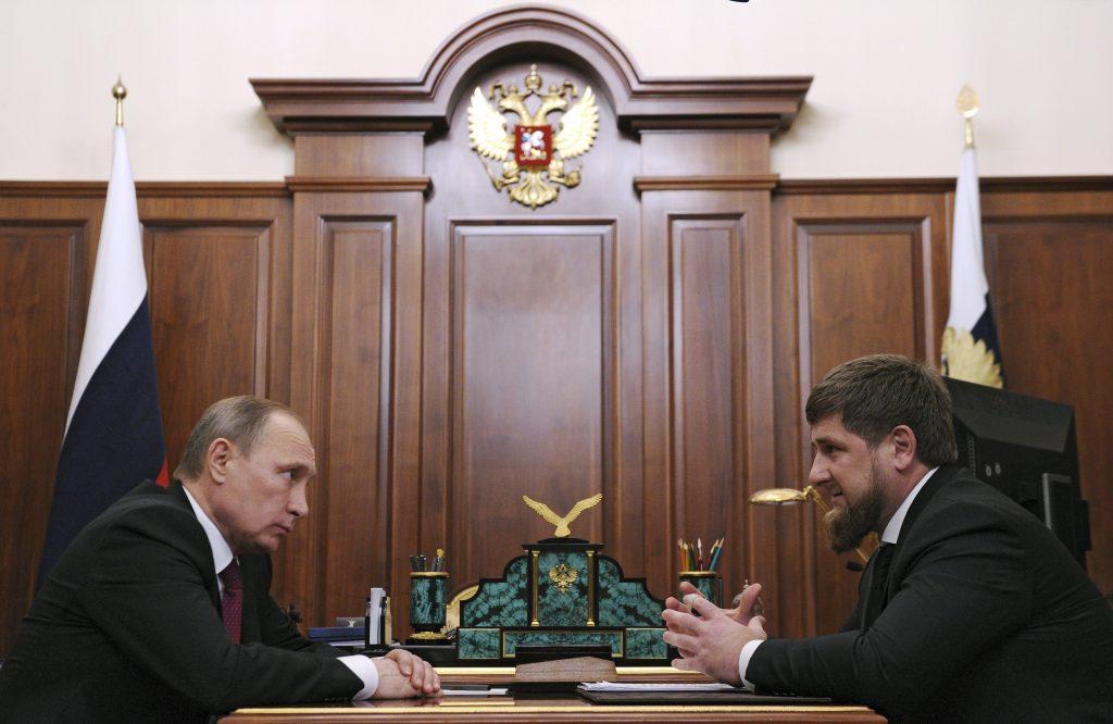 Russian President Vladimir Putin (L) meets with Chechnya's leader Ramzan Kadyrov at the Kremlin in Moscow, Russia, in 2015. Photo by Mikhail Klimentyev/Sputnik/Kremlin via Reuters