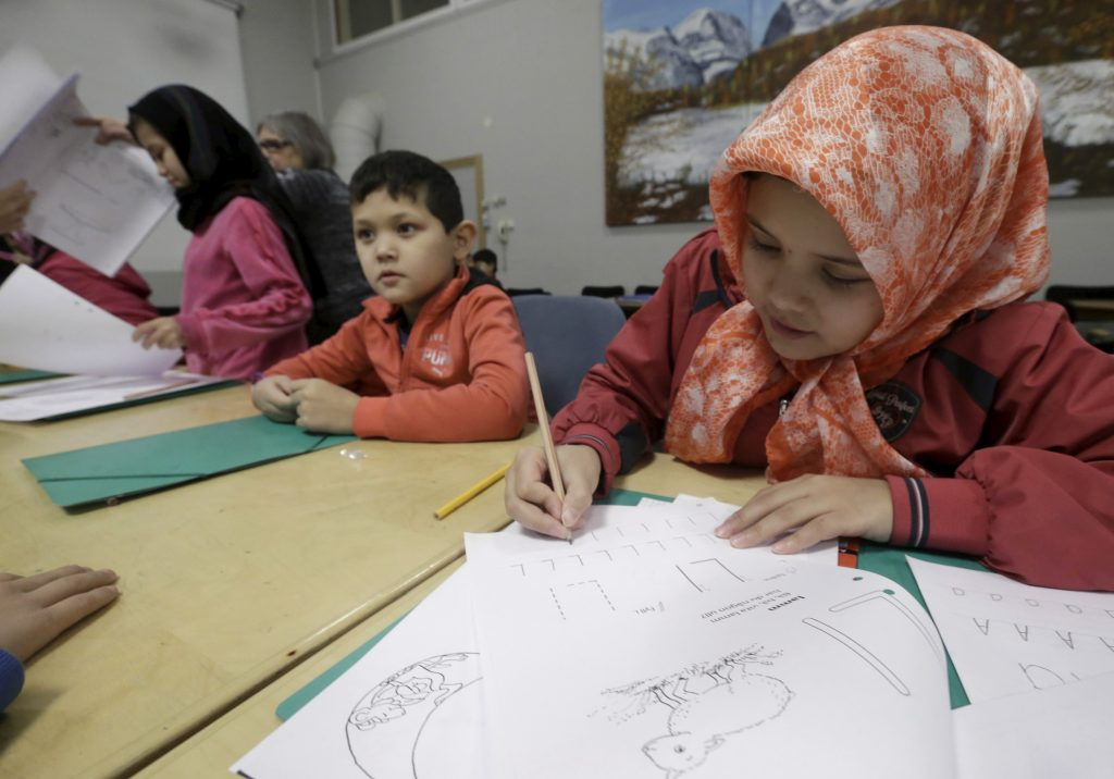 Refugee children attend class in a camp at a hotel touted as the world's most northerly ski resort in Riksgransen, Sweden. Picture taken in 2015. Photo by Ints Kalnins/Reuters