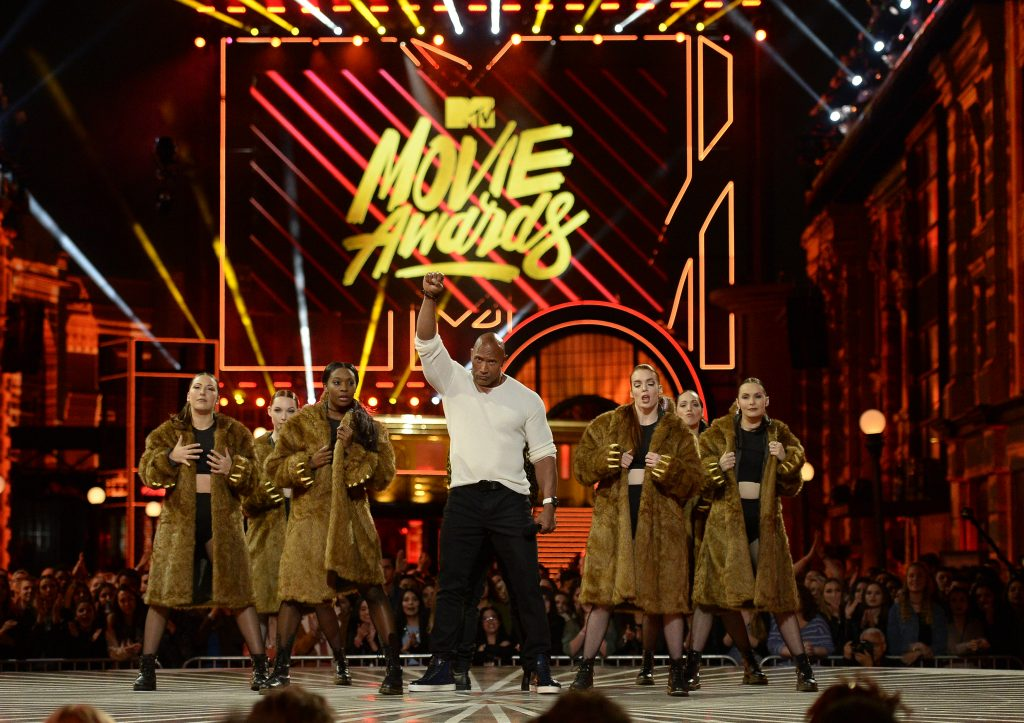 Host Dwayne Johnson performs a dance number in this pool photo during the 2016 MTV Movie Awards in Los Angeles. Photo by Kevork Djansezian/Reuters