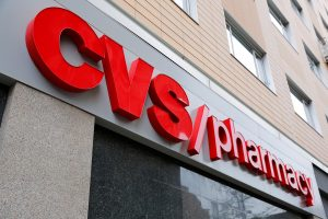A sign is photographed outside of a CVS Pharmacy in New York